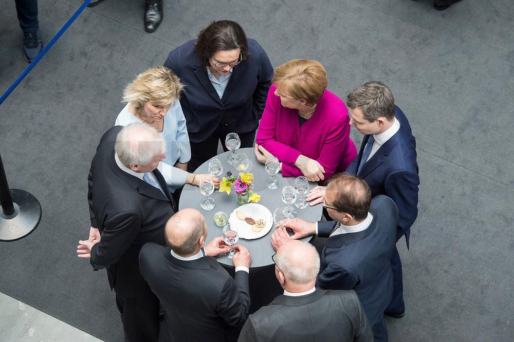 12 MAR 2018, BERLIN/GERMANY:<br /> Angela Merkel (in pink), CDU, Bundeskanzlerin, Thomas Silberhorn, desig. Parl. Staatssekretaer im Bundesministerium für Verteidigung, Alexander Dobrindt, Vorsitzender der CSU Landesgruppe,  Volker Kauder, CDU, CDU/CSU Fraktionsvorsitzender, Olaf Scholz, SPD, desig. Bundesfinanzminister, Horst Seehofer, CSU, desig. Bundesinnenminister, Daniela Ludwig, MdB, CSU, Vorsitzende der Arbeitsgruppe Verkehr und digitale Infrastruktur, Andrea Nahles, SPD Fraktionsvorsitzende, nach der Unterzeichnung des Koalitionsvertrages der CDU/CSU und SPD, Paul-Loebe-Haus, Deutscher Bundestag<br /> IMAGE: 20180312-02-038