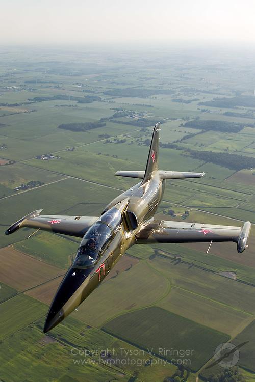 Larry Labriola pilots his camo-green L-39 Albatros over Wisconsin..