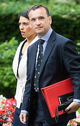 Downing Street,  London, June 27th 2015. Employment Minister Priti Patel and Welsh Secretary Alun Cairns arrive for the first post-Brexit cabinet meeting at 10 Downing Street
