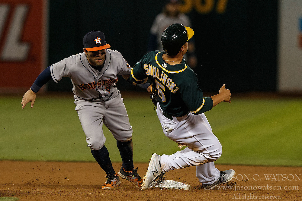 OAKLAND, CA - JULY 19:  Jake Smolinski #5 of the Oakland Athletics is tagged out attempting to steal second base by Jose Altuve #27 of the Houston Astros during the fifth inning at the Oakland Coliseum on July 19, 2016 in Oakland, California. The Oakland Athletics defeated the Houston Astros 4-3 in 10 innings.  (Photo by Jason O. Watson/Getty Images) *** Local Caption *** Jake Smolinski; Jose Altuve