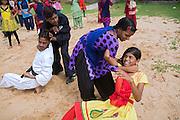 Tabasum Khatun, 14, and her best friend Anju Kumari, 13, (centre) are practising a Karate counter-attack move during a class in Algunda village, pop. 1000, Giridih District, rural Jharkhand, India.