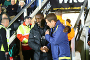 Southend Manager Chris Powell and Burton Albion manager Nigel Clough during the EFL Sky Bet League 1 match between Burton Albion and Southend United at the Pirelli Stadium, Burton upon Trent, England on 2 October 2018.
