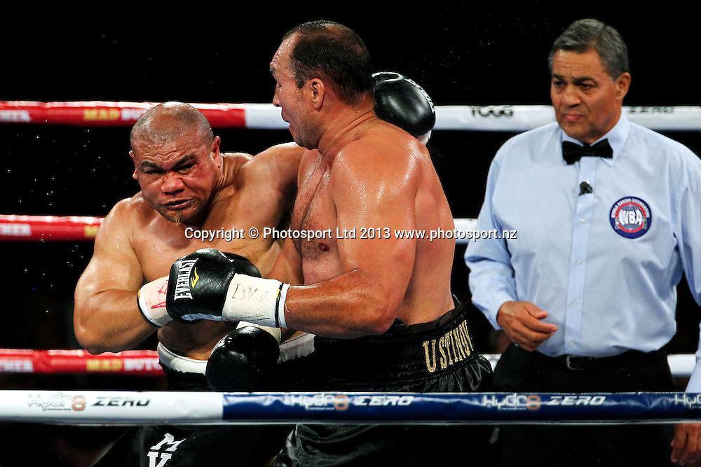 David Tua (L) fights Alexander Ustinov (R). David Tua v Alexander Ustinov. Hydr8 Zero, David v Goliath by Duco Events, Claudelands Event Centre, Hamilton, New Zealand. Saturday 16th November 2013. Mandatory Photo Credit: Anthony Au-Yeung www.photosport.co.nz