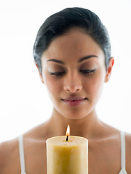 Jul. 26, 2012 - Woman with candle (Credit Image: © Image Source/ZUMAPRESS.com)