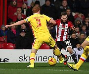 Milton Keynes Dons defender Dean Lewington trying to tackle Brentford midfielder Alan Judge during the Sky Bet Championship match between Brentford and Milton Keynes Dons at Griffin Park, London, England on 5 December 2015. Photo by Matthew Redman.