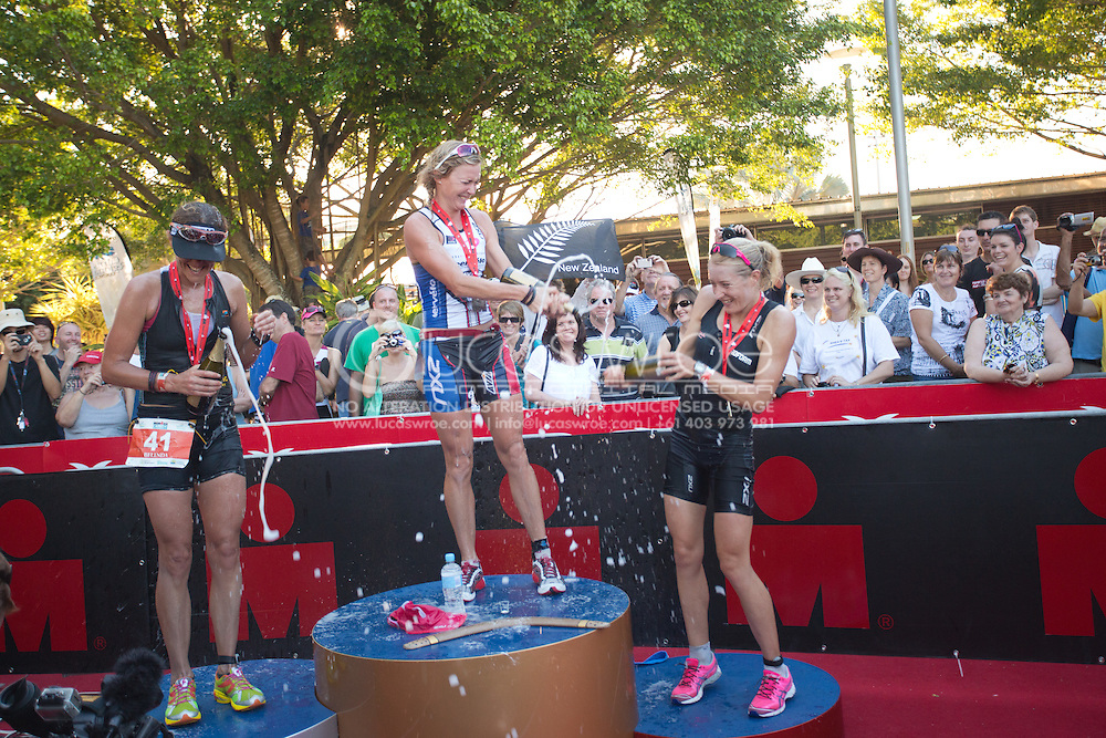 Belinda Harper (AUS), Carrie Lester (AUS) And Candice Hammond (AUS) Spray The Champagne On The Podium. 2012 Ironman Cairns Triathlon. Cairns, Queensland, Australia. 03/06/2012. Photo By Lucas Wroe.