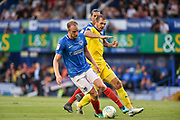 Portsmouth Defender, Matt Clarke (5) tackles AFC Wimbledon Forward, James Hanson (18) during the Carabao Cup match between Portsmouth and AFC Wimbledon at Fratton Park, Portsmouth, England on 14 August 2018.
