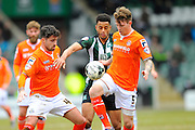 Luton Town's Alan Sheehan and Luton Town's Glen Rea shield's the ball from Plymouth Argyle's Curtis Nelson during the Sky Bet League 2 match between Plymouth Argyle and Luton Town at Home Park, Plymouth, England on 19 March 2016. Photo by Graham Hunt.