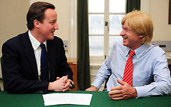 Leader of the Conservative Party David Cameron with Michael Fabricant, Member of Parliament for Lichfield in his office in Norman Shaw South, January 11, 2010. Photo By Andrew Parsons / i-Images.<br />