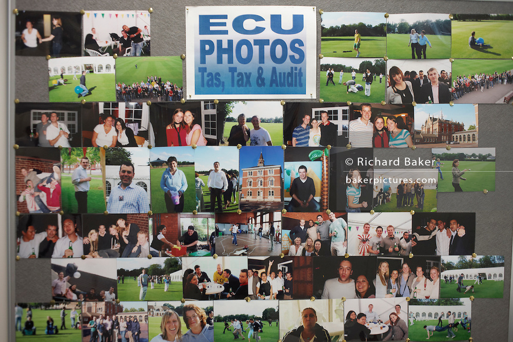 Work colleagues and friends' pictures displayed on a board in an auditing company's London headquarters