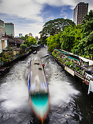 22 OCTOBER 2014 - BANGKOK, THAILAND: A river bus takes commuters down Khlong Saen Saeb into Bangkok.        PHOTO BY JACK KURTZ