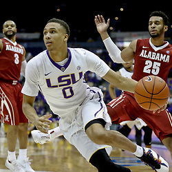 Jan 14, 2017; Baton Rouge, LA, USA; LSU Tigers guard Brandon Sampson (0) drives past Alabama Crimson Tide forward Braxton Key (25) during the second half of a game at the Pete Maravich Assembly Center. Alabama defeated LSU 81-66. Mandatory Credit: Derick E. Hingle-USA TODAY Sports