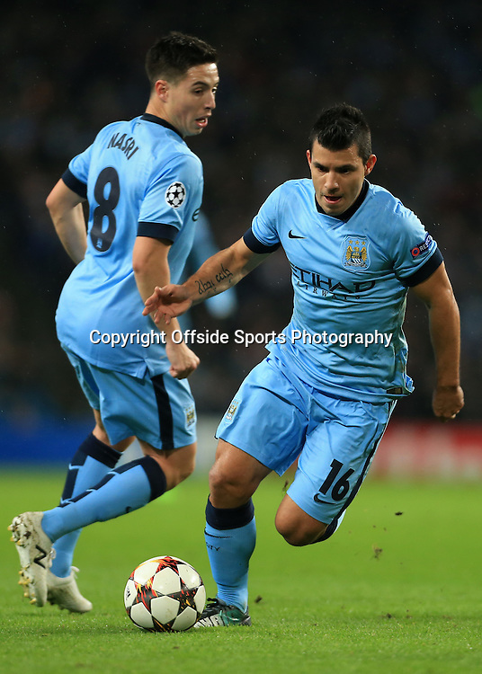 25th November 2014 - UEFA Champions League - Group E - Manchester City v Bayern Munich - Sergio Aguero of Man City (R) and Samir Nasri of Man City - Photo: Simon Stacpoole / Offside.