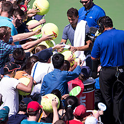 August 30, 2017 - New York, NY : Fans clamor for autographs from Grigor Dimitrov, in blue with towel at top right, after he defeated Vaclav Safranek, not visible, in the Grandstand on the third day of the U.S. Open, at the USTA Billie Jean King National Tennis Center in Queens, New York, on Wednesday. <br /> CREDIT : Karsten Moran for The New York Times