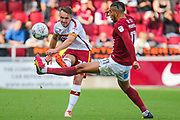 Bradford City defender Tony McMahon strikes the ball as Northampton Town midfielder Daniel Powell tries to block the ball during the EFL Sky Bet League 1 match between Northampton Town and Bradford City at Sixfields Stadium, Northampton, England on 23 September 2017. Photo by Aaron  Lupton.