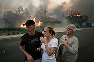 Nov 15, 2008 - Yorba Linda, California, USA -A distraught family are distraught as fire ravages their Yorba Linda neighborhood during an out of control wildfire whipped up by Santa Ana winds ..Credit Image: © Jonathan Alcorn/ZUMA Press)