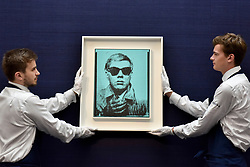 "© Licensed to London News Pictures. 23/06/2017. London, UK. Technicians show ""Self-Portrait"", 1963-64, by Andy Warhol (estimate GBP5-7m) at the preview of Sotheby's Contemporary Art Sale in New Bond Street.  The auction, which is dominated by Pop art, takes place on 28 June. Photo credit : Stephen Chung/LNP"