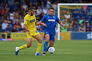 AFC Wimbledon midfielder Anthony Hartigan (8) battles for possession with Wycombe Wanderers midfielder Nick Freeman (22) during the EFL Sky Bet League 1 match between AFC Wimbledon and Wycombe Wanderers at the Cherry Red Records Stadium, Kingston, England on 31 August 2019.