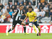 Football - 2019 / 2020 Premier League - Newcastle United vs. Arsenal<br /> <br /> Reiss Nelson of Arsenal vies with Isaac Hayden of Newcastle United at St James' Park.<br /> <br /> COLORSPORT/BRUCE WHITE