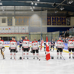 WHITBY, - Dec 18, 2015 -  Game #12 - Bronze Medal Game, Team Canada East vs. United States at the 2015 World Junior A Challenge at the Iroquois Park Recreation Complex, ON. Team Canada East during the National Anthem.<br /> (Photo: Shawn Muir / OJHL Images)