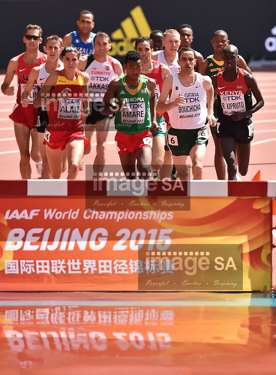 BEIJING, CHINA - AUGUST 22: Roberto Alaiz (Spain), Hailemariyam Amare (Ethiopia), Hicham Bouchicha (Algeria) and Brimin Kiprop Kipruto (Kenya) at the water jump in Round 1 of the mens 3000m steeplechase during day 1 of the 2015 IAAF World Championships at National Stadium on August 22, 2015 in Beijing, China. (Photo by Roger Sedres/Gallo Images)