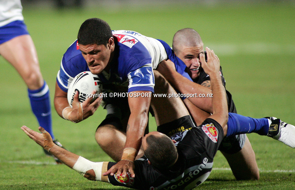 Bulldogs prop Willie Mason is tackled by Corey Lawrie and Russell Packer during the preseason NRL match between the Vodafone Warriors and Bulldogs held at Albany Stadium, Auckland, on Saturday 3 March 2007. Photo: Renee McKay/PHOTOSPORT