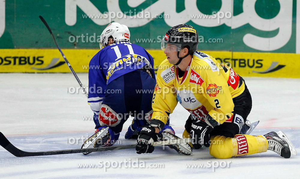 22.09.2013, Stadthalle, Villach, AUT, EBEL, EC VSV vs UPC Vienna Capitals, 9. Runde, im Bild Derek Ryan (VSV,#11) und Peter Schweda (Capitals,#2) // during the Erste Bank Icehockey League 9th round between EC VSV vs UPC Vienna Capitals at the City Hall, Villach, Austria, 2013/09/22, EXPA Pictures © 2013, PhotoCredit: EXPA/ Oskar Hoeher