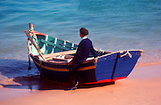 PORTUGAL, ALGARVE, SOUTH COAST Albufeira, fishing port and popular resort, fishermen and boats on beach