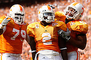 KNOXVILLE, TN - SEPTEMBER 12: A group of Tennessee Volunteers players including Montario Hardesty #2, Kevin Cooper #45 and Chris Scott #79 celebrate after a touchdown against the UCLA Bruins at Neyland Stadium on September 12, 2009 in Knoxville, Tennessee. The Bruins won 19-15. (Photo by Joe Robbins) *** Local Caption *** Montario Hardesty;Kevin Cooper;Chris Scott