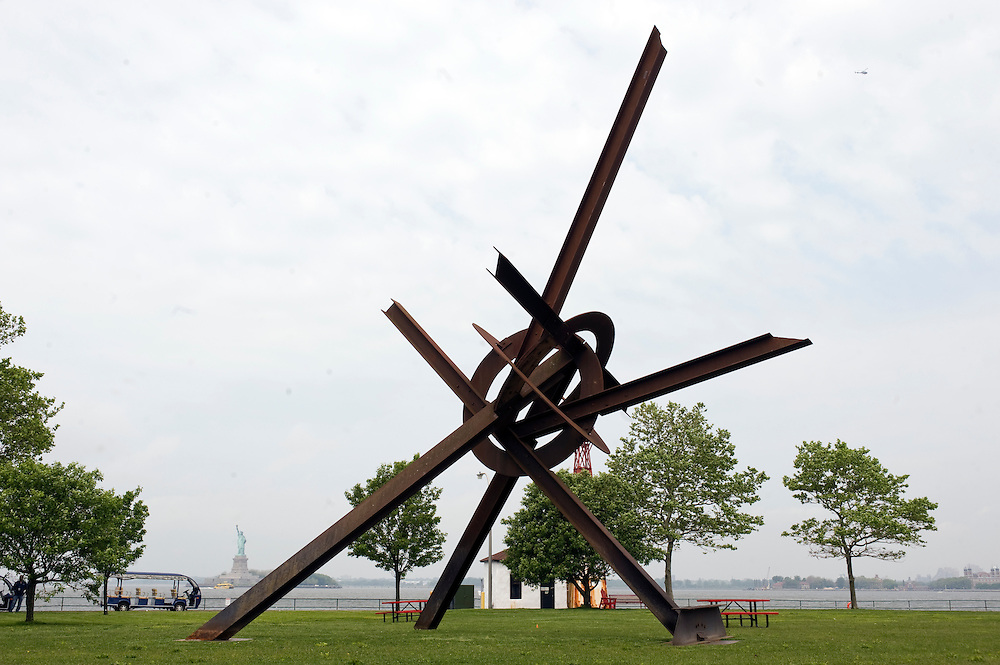 Sculptures by Mark di Suvero at Governors Island, New York, presented by Storm King Art Center. The show opens Friday May 27th - Sunday, September 25, 2011. Statue of Liberty visible in back..The exhibition is the largest outdoor presentation of Mark di Suvero's sculptures to be shown in New York City since the 1970s and includes loans from public and private collection