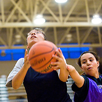 111412       Cable Hoover<br /> <br /> Timara Jim escapes the reach of Victoria Hickman, right, for a layup during girls basketball practice at Miyamura High School Wednesday.