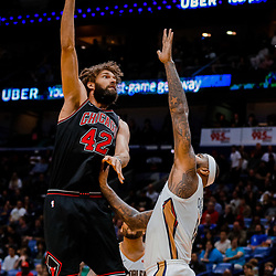 Jan 22, 2018; New Orleans, LA, USA; Chicago Bulls center Robin Lopez (42) shoots over New Orleans Pelicans center DeMarcus Cousins (0) during the second quarter at  the Smoothie King Center. Mandatory Credit: Derick E. Hingle-USA TODAY Sports