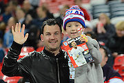 A young England fan with his father during the Group E UEFA European 2016 Qualifier match between England and Estonia at Wembley Stadium, London, England on 9 October 2015. Photo by Alan Franklin.