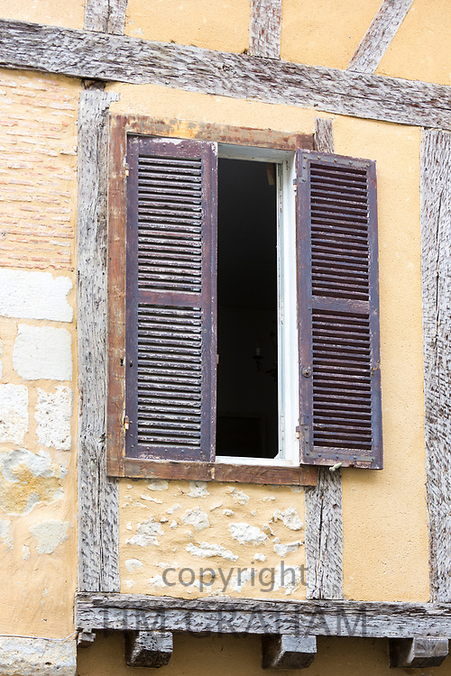 Half timber medieval old architecture and shutters in 13th Century bastide  town of Eymet in Aquitaine, France