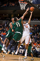 Virginia guard Sylven Landesberg (15) shoots over South Florida center Alex Rivas Sanchez (11).  The Virginia Cavaliers defeated the South Florida Bulls 77-75 at the University of Virginia's John Paul Jones Arena in Charlottesville, VA on November 19, 2008.