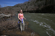 Danielle and David lowered the KY boom on the Caney Fork River, Monday, March 16, 2015 at Rock Island State Park in Tennessee.