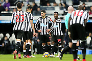 Ayoze Perez (#17) of Newcastle United and Christian Atsu (#30) of Newcastle United discuss a Newcastle United free kick with Jamaal Lascelles (#6) of Newcastle United during the Premier League match between Newcastle United and Burnley at St. James's Park, Newcastle, England on 31 January 2018. Photo by Craig Doyle.