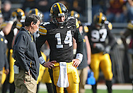 November 21, 2009: Iowa offensive coordinator Ken O'Keefe talks with Iowa quarterback John Wienke (14) before the Iowa Hawkeyes 12-0 win over the Minnesota Golden Gophers at Kinnick Stadium in Iowa City, Iowa on November 21, 2009.