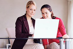 Dec. 14, 2012 - Two women using laptop computer (Credit Image: © Image Source/ZUMAPRESS.com)