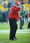 Kansas City Chiefs head coach Andy Reid points and smiles as he walks onto the field before the 2015 NFL week 3 regular season football game against the Green Bay Packers on Monday, Sept. 28, 2015 in Green Bay, Wis. The Packers won the game 38-28. (©Paul Anthony Spinelli)