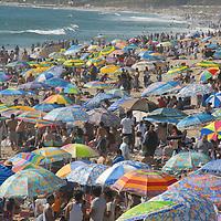 A sea of umbrellas invade the Santa Monica Coastline on Sunday, April 13, 2008. Temperatures reached 93 degrees along the coast on Sunday.
