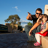 USA, New Mexico, Santa Fe, Father and daughter wait for arriving train at Santa Fe Depot Station
