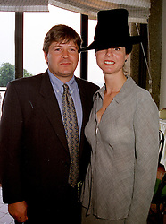 MR GEORGE & the HON.MRS CASE she is the sister of the Countess of March, at a race meeting in West Sussex on 30th July 1999.MUP 31