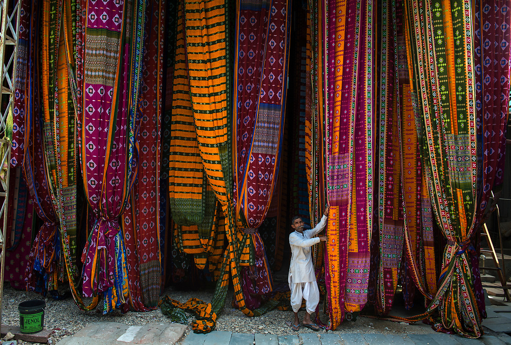 Freshly printed sarees hang to dry on bamboo racks in the town of Pali in Rajasthan. The dyeing process is highly polluting which has caused the Indian government to close down many of the factories.