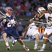Mike Manley #5 of the Rochester Rattlers watches the shot of Kevin Buchanan #27 of the Boston Cannons during the game at Harvard Stadium on August 9, 2014 in Boston, Massachusetts. (Photo by Elan Kawesch)