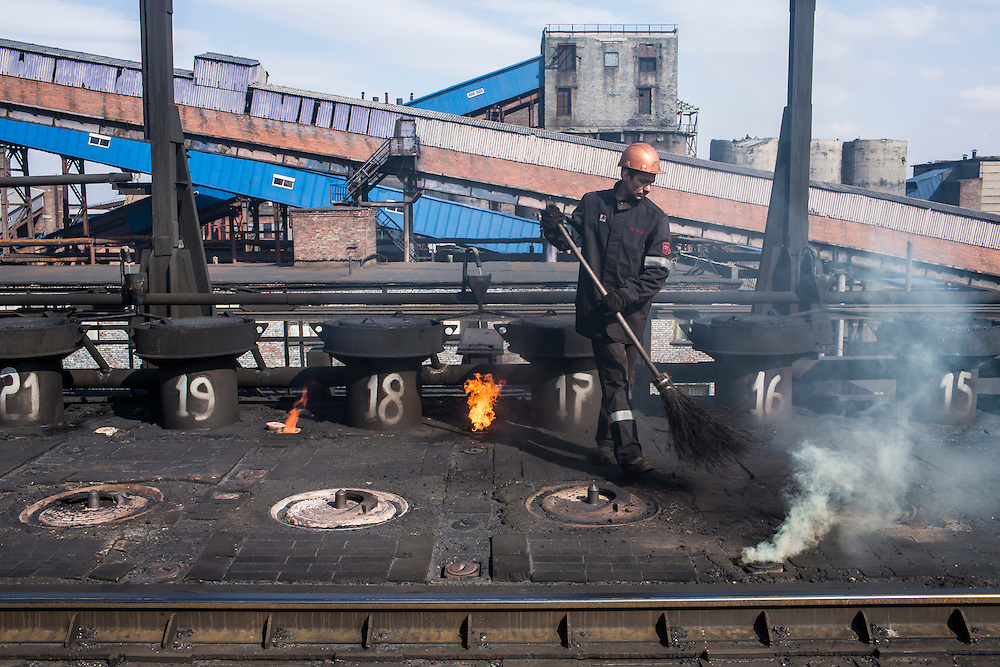 AVDIIVKA, UKRAINE - MARCH 18, 2015: A worker at the Avdiivka Coke and Steel plant tends to the furnaces in Avdiivka, Ukraine. CREDIT: Brendan Hoffman for The New York Times