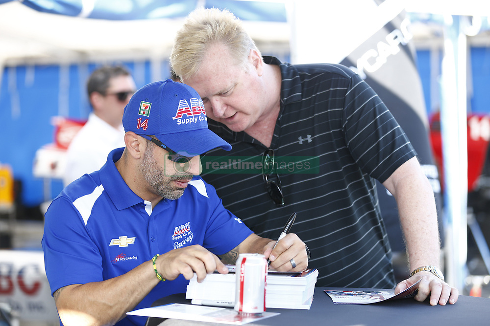 April 13, 2018 - Long Beach, California, United States of America - April 13, 2018 - Long Beach, California, USA: Matheus Leist (4) and Tony Kanaan (14) sign autographs for fans following practice for the Toyota Grand Prix of Long Beach at Streets of Long Beach in Long Beach, California. (Credit Image: © Justin R. Noe Asp Inc/ASP via ZUMA Wire)