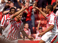Photo. Glyn Thomas.Digitalsport<br /> Stoke City v Wolverhampton Wanderers. <br /> Coca Cola Championship. 08/08/2004.<br /> Stoke's Darel Russell (C) celebrates after scoring his side's first goal.