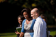 (photo by Matt Roth).Wednesday, October 21, 2009.Assignment ID: 30087135A..White House assistant chef Sam Kass walks with Michelle Obama during The White House Healthy Kids Fair held on the South Lawn Wednesday, October 21, 2009. Before becoming the assistant White House chef, Sam Kass was the Obamas' personal chef.