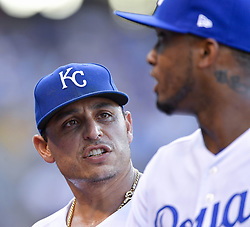 July 17, 2017 - Kansas City, MO, USA - Kansas City Royals starting pitcher Jason Vargas talks with shortstop Alcides Escobar as they walk off the field after Vargas loaded the bases and walked in a run in the first inning against the Detroit Tigers Monday, July 17, 2017 at Kauffman Stadium in Kansas City, Mo. (Credit Image: © John Sleezer/TNS via ZUMA Wire)
